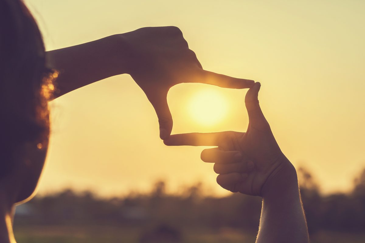 Hands Framing Sun